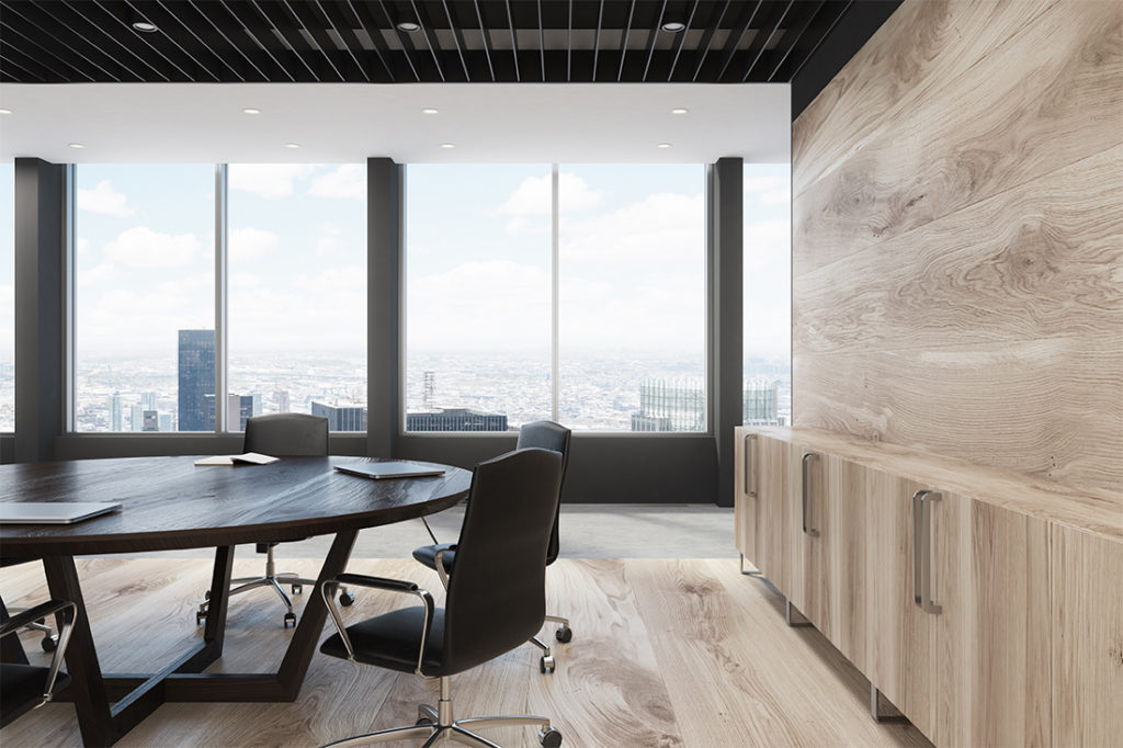 Close up of a light wooden wall decoration and a large round meeting room table. 3d rendering mock up